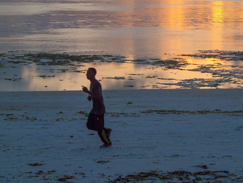 Jogger at beach in Zanzibar