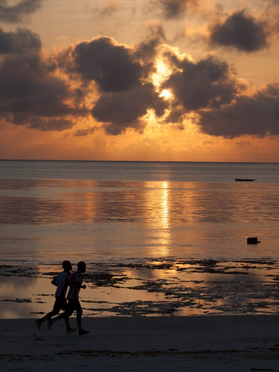 Sunset with Joggers in Zanzibar